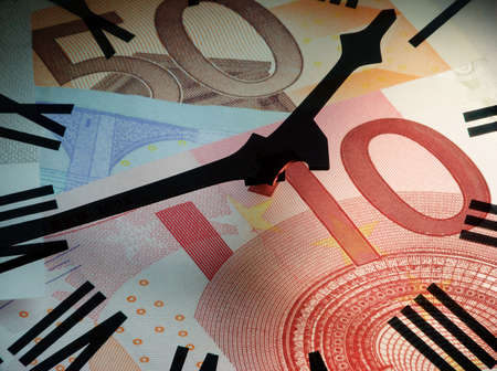 Clock face overlaid on to Euro bank notes. Concept: time is money.