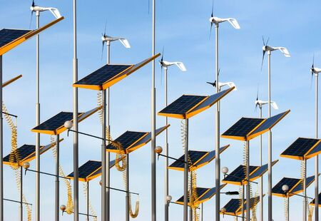 Conserving energy by using wind generators and solar panels photo
