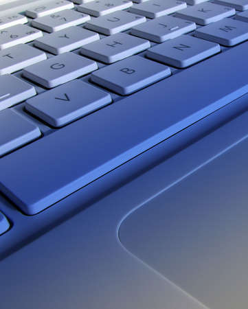 Closeup of laptop keyboard with blue lighting effect Stock Photo