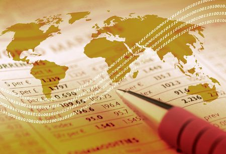 World outline map overlaid on financial newspaper. Stock Photo