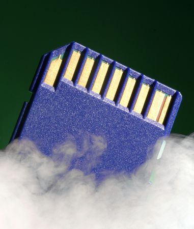 digital memory: Digital memory card on green background over laid with smoke effect.