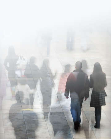 crowds': Crowd of shoppers with faded lighting effect. Stock Photo