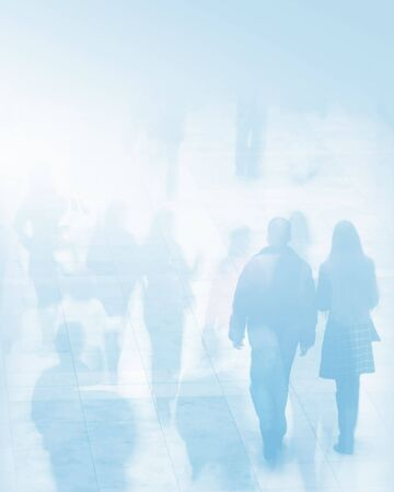 Crowd of shoppers in shopping mall. Two images overlaid to give ghosting effect. Coloured light blue. Stock Photo - 886618