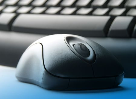 overlay: Computer keyboard and mouse with blue overlay, Focussed on mouse wheel Stock Photo