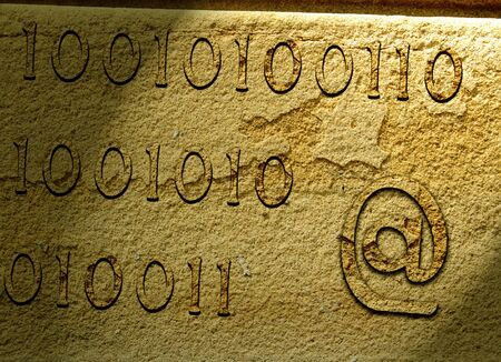 stoneage: Illustration of e-mail symbol and numbers carved on stone.