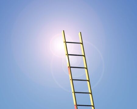 the flair: Builders ladder reaching into clear blue sky with added lens flair effect. Stock Photo