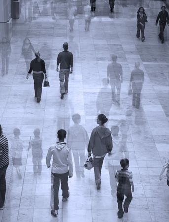Suureal image of people in shopping mall. Overlaid with faded image for effect.