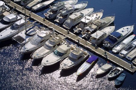 monaco: Collection of luxury boats moored in Monaco marina.