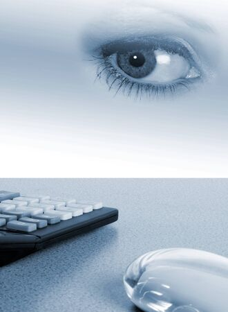 Illustration of desktop with calculator and computer mouse. Womans eye overlaid giving surreal effect Stock Photo