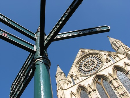 york minster: Sign post pointing to York attractions in front of York Minster.