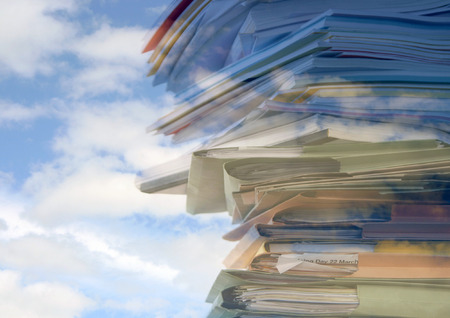 over worked: Stack of office folders, reports and paperwork overlaid with cloud pattern Stock Photo
