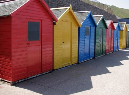 whitby: Colorful beach huts. Whitby, North Yorkshire, Uk.