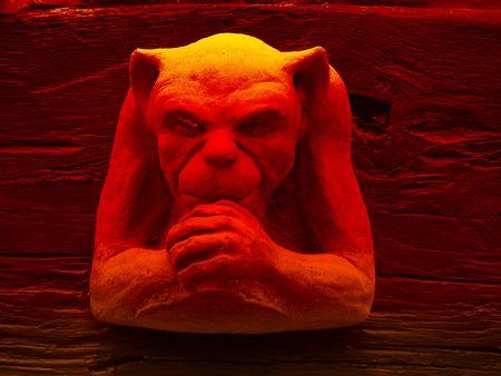 gremlin: Carved gargoyle stulpture with red lighting effect.