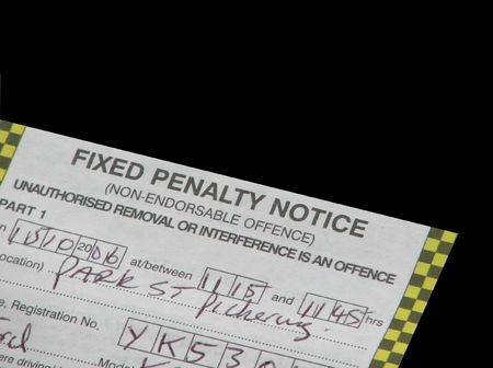 parking ticket: Close up of UK parking ticket on black Stock Photo