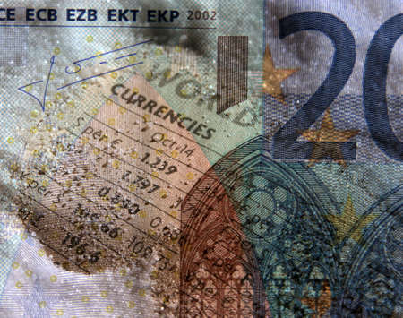 composite image: Composite image of currency figures overlaid on euro bank note