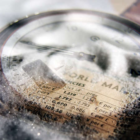 composite: Composite image of financial figures overlaid with watch