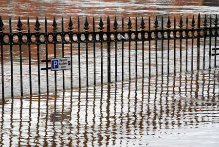 ouse: Reflections of railings as River Ouse bursts its banks. York, North Yorkshire, UK.