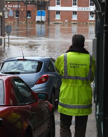 Man from environmental agency report on flood situation. York, North Yorkshire, UK. Stock Photo
