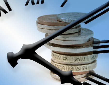 Clock face overlaid on to UK coinage Stock Photo