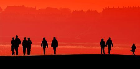 Silhouettes of people on Scarborough pier. People filled with black. Stock Photo - 2626683