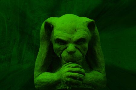gremlin: Green gargoyle figure on grunge background