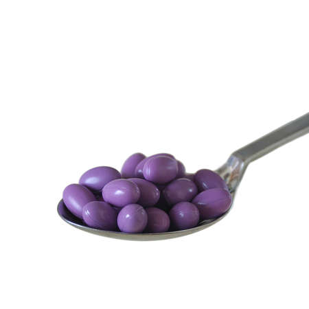 Table spoon of pills over white background Stock Photo - 2767750