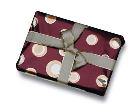 Present wrapped in red paper with golden ribbon photo