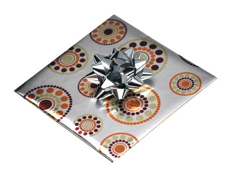 Gift wrapped in silver foil paper on white photo