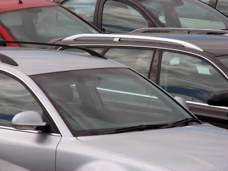 Telephoto view of cars parked in parking lot Stock Photo