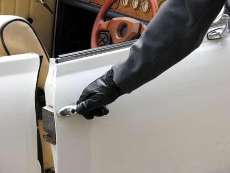 Close-up of chauffeur opening door of wedding car photo