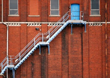 Image of blue fire escape on brick building Stock Photo - 3243061