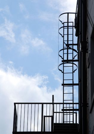 Fire escape silhouette against blue cloudy sky Stock Photo - 3276703