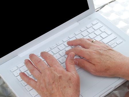Close-up of elderly woman using computer laptop