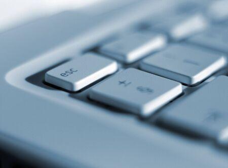 escape key: Focussed on escape key on laptop keyboard