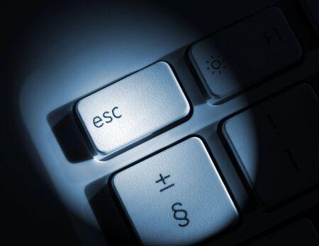 escape key: Spolight effect applied to laptop escape key