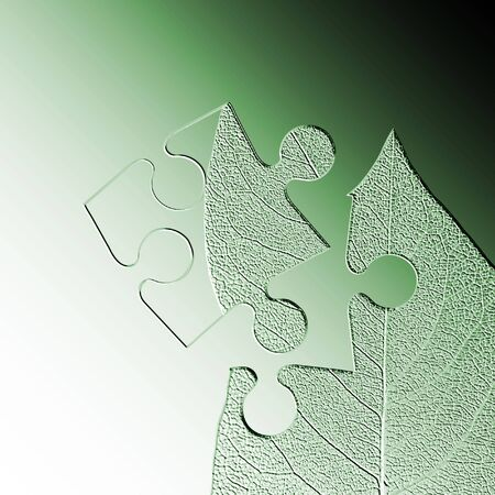 embossed: Embossed jigsaw piece of leaf on green graduated background