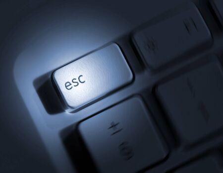 escape key: Spin effect applied to escape key on laptop keyboard