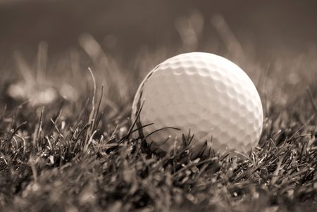 Sepia toned close-up of golfball in grass Stock Photo - 3550700