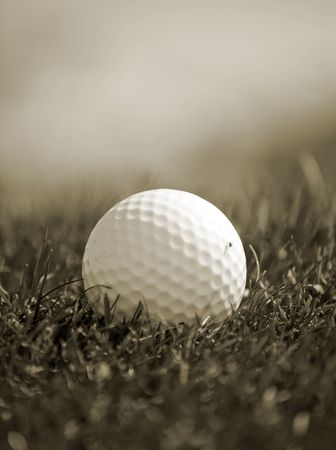 Sepia toned close-up of golfball in grass Stock Photo - 3582865