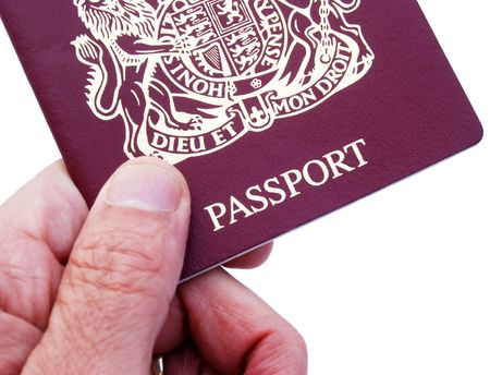 british man: Male hand holding British 10 year Passport Stock Photo
