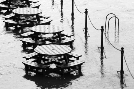 ouse: Flooded tables on bank of River Ouse in York. Stock Photo