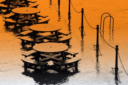 ouse: Flooded tables on bankcof River Ouse in York.