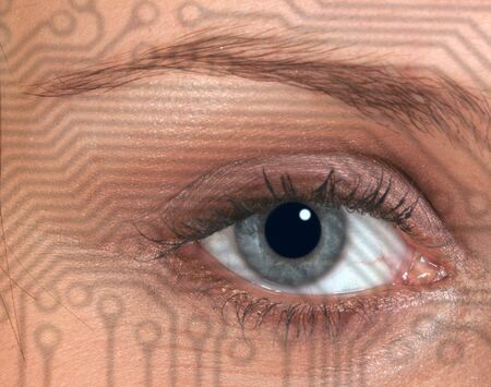 Circuit board pattern overlaid onto eye of woman photo