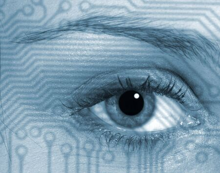 Eye of woman overlaid on to circuit board pattern photo