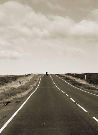 moors: Motorcycles travel down country road in Yorkshire moors