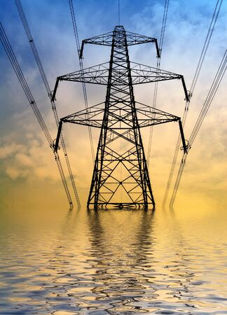 catastrophic: Silhouette of electricity pylon with flood water effect