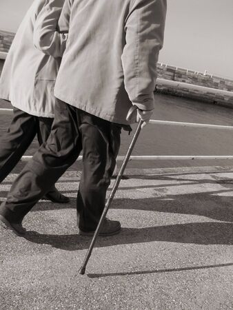 Sepia toned image of elderly couple strolling Stock Photo