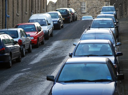 Telephoto view of cars parked on urban street in North Yorkshire