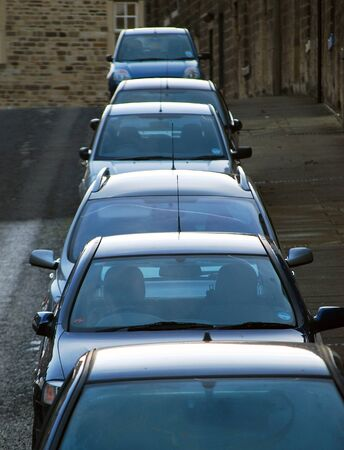Telephoto view of cars parked in urban street. North Yorkshire, UK. photo