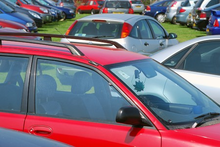 Cars parking on grass in parking lot Stock Photo - 4136061